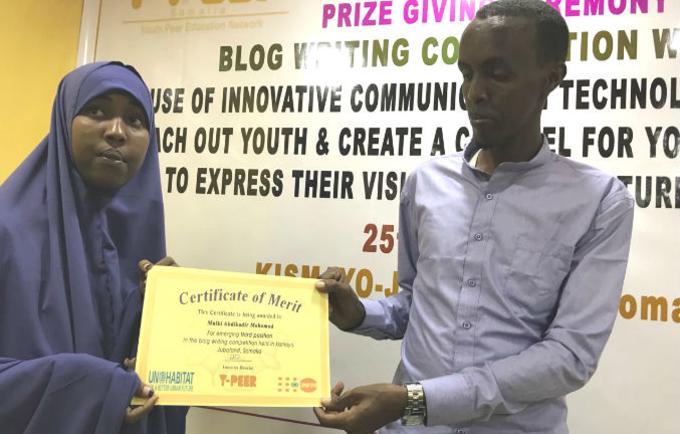 Ms. Mulki Abdiqadir Mohamed receives her certificate